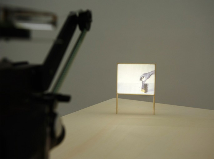 Composing a Battle for Narrative, 2011, film 16mm, screen in pine wood; installation view at Monitor, Rome