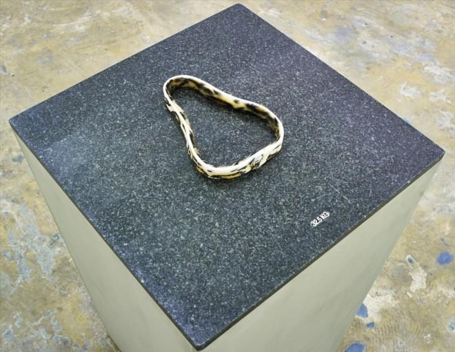 Eric Bainbridge, Slip, 2014, Fur fabric, granite, plinth, 115 x 60 x 60 cm