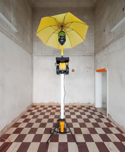 Graham Hudson, Major Trauma, 2017  Tripod LED lamp, Tonka toy truck, LED lamp. SERIOUS MASS protein jar, umbrella; Approx. 3 m height (Installation view at MONITOR Lisbon)