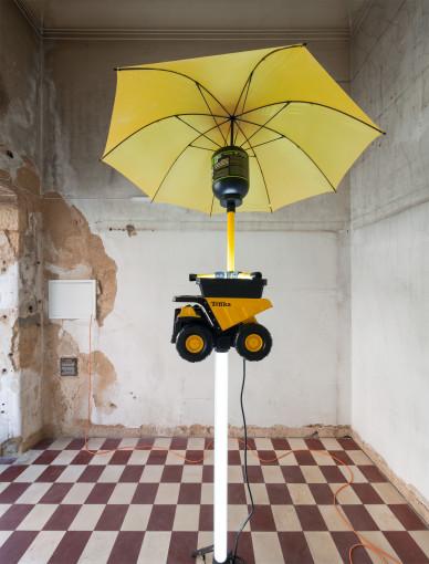 Graham Hudson, Major Trauma, 2017  Tripod LED lamp, Tonka toy truck, LED lamp. SERIOUS MASS protein jar, umbrella; Approx. 3 m height