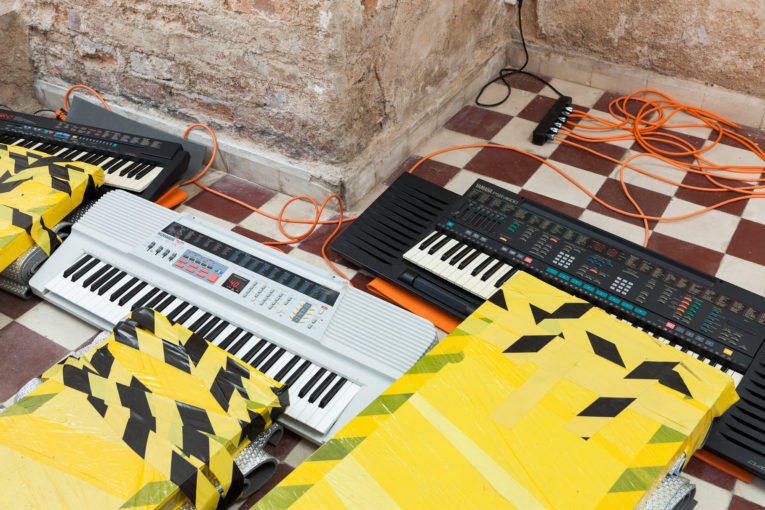 Graham Hudson, Untitled, 2017  Installation: 7 electronic keyboards, 7 wooden boards, yoga mats, cling film, tape, extensions; Variable dimensions (Detail)